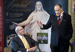 Vaughn J. Featherstone (left) takes in a 2009 Young Men's address by LdS President Thomas S. Monson